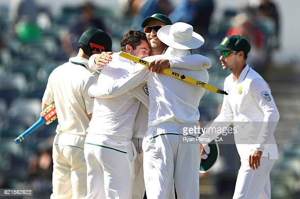 Stephen Cook Faf du Plessis and Hashim Amla of South Africa celebrate victory after day five of the First Test match between Australia and South...