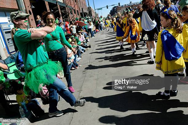 Stephen Cote demonstrates his ability to students from the Wick School of Irish Dance during the Annual StPatricks day parade in Denver CO March 14...