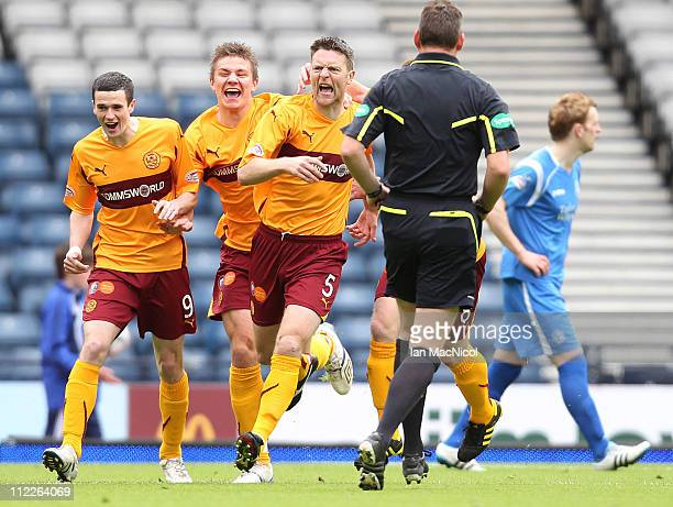 Stephen Craigan of Motherwell celebrates with team-mates after scoring the opening goal of the Scottish Cup semi-final between Motherwell and St...