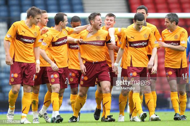Stephen Craigan of Motherwell is congratulated by team-mates after scoring the opening goal of the Scottish Cup semi-final between Motherwell and St...