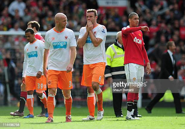 Stephen Crainey and Ian Evatt of Blackpool look dejected as Blackpool are relegated after the Barclays Premier League match between Manchester United...