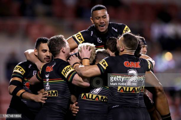 Stephen Crichton and the Panthers celebrate after Viliame Kikau of the Panthers scored a try during the round 15 NRL match between the Penrith...