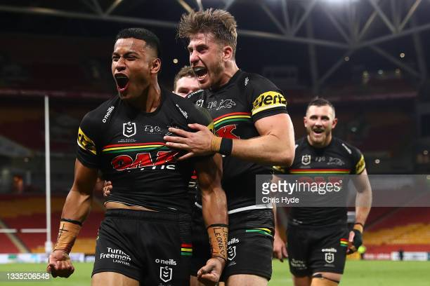 Stephen Crichton of the Panthers celebrates scoring a try with team mates during the round 23 NRL match between the Penrith Panthers and the South...
