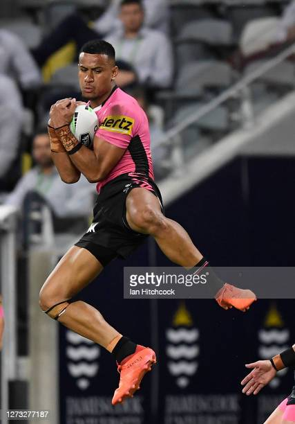 Stephen Crichton of the Panthers takes a high ball during the round 19 NRL match between the North Queensland Cowboys and the Penrith Panthers at QCB...