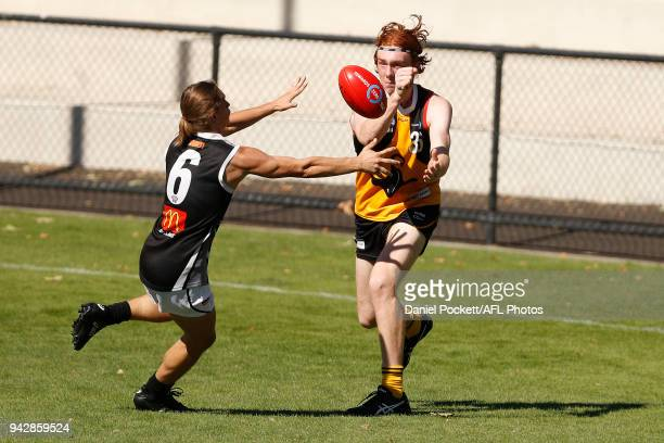 Stephen Cumming of the Stingrays handpasses the ball under pressure during the round three TAC Cup match between Dandenong Stingrays and Greater...