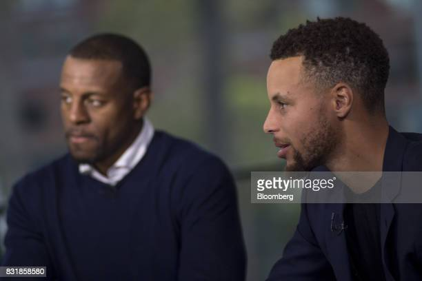 Stephen Curry a professional basketball player with the National Basketball Association's Golden State Warriors right speaks during a Bloomberg...