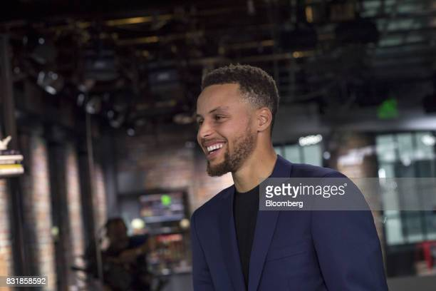 Stephen Curry a professional basketball player with the National Basketball Association's Golden State Warriors smiles following a Bloomberg...