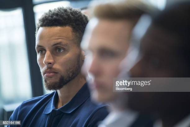 Stephen Curry a professional basketball player with the National Basketball Association's Golden State Warriors listens to a panel discussion during...