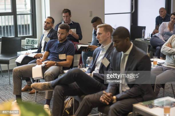 Stephen Curry a professional basketball player with the National Basketball Association's Golden State Warriors second left listens to a panel...