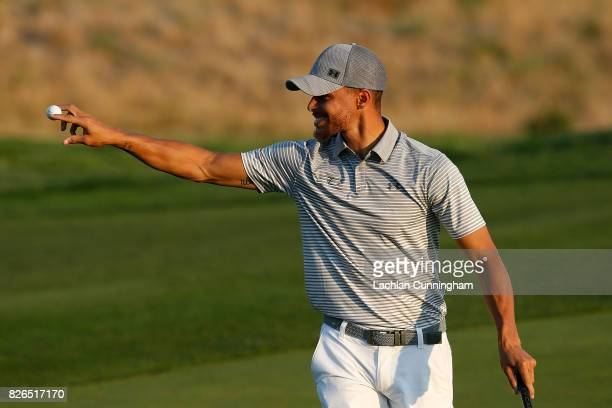 Stephen Curry acknowledges the fans on the seventeenth green after scoring a birdie during round two of the Ellie Mae Classic at TCP Stonebrae on...