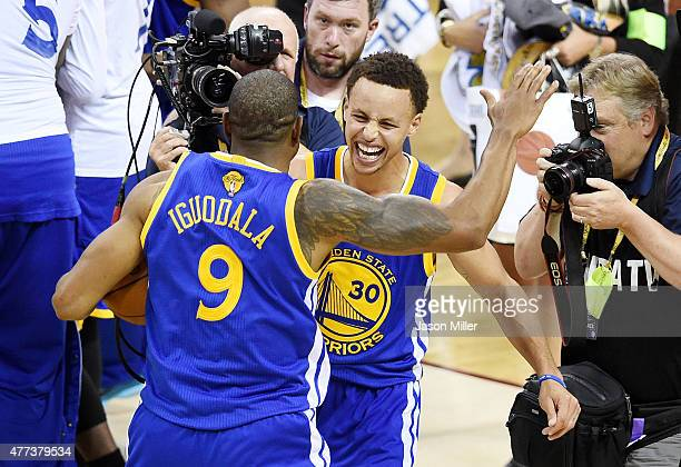 Stephen Curry and Andre Iguodala of the Golden State Warriors celebrate after defeating the Cleveland Cavaliers 105 to 97 during Game Six of the 2015...