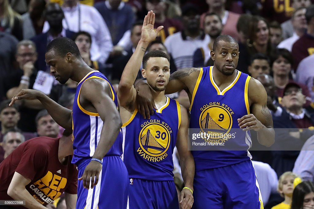 Stephen Curry #30 and Andre Iguodala #9 of the Golden State Warriors walk off the court during a time out against the Cleveland Cavaliers during the fourth quarter in Game 4 of the 2016 NBA Finals at Quicken Loans Arena on June 10, 2016 in Cleveland, Ohio.