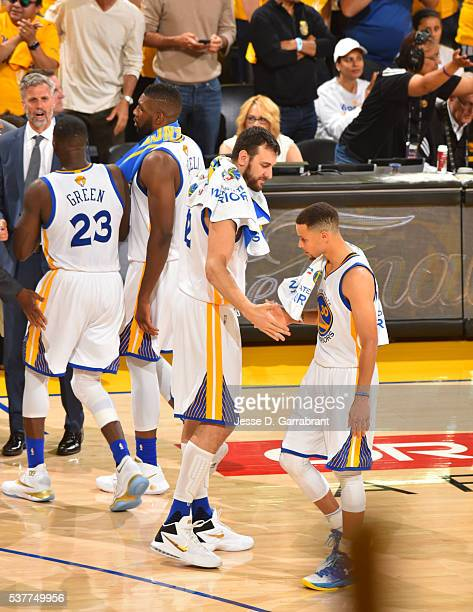 Stephen Curry and Andrew Bogut of the Golden State Warriors looks on against the Cleveland Cavaliers during the 2016 NBA Finals Game One on June 2...