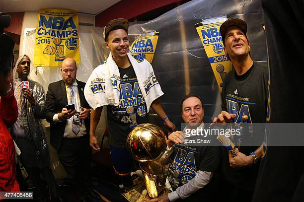 Stephen Curry and David Lee of the Golden State Warriors celebrate with team owners Peter Guber and Joe Lacob and the Larry O'Brien NBA Championship...