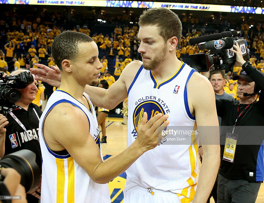 Stephen Curry #30 and David Lee #10 of the Golden State Warriors embrace after losing to the San Antonio Spurs in Game Six of the Western Conference Semifinals during the 2013 NBA Playoffs on May 16, 2013 at the Oracle Arena in Oakland, California. The Spurs won 94-82 to take the series 4-2. .