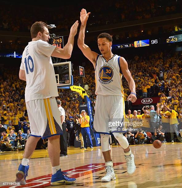 Stephen Curry and David Lee of the Golden State Warriors give high fives fter a place against the Cleveland Cavaliers at the Oracle Arena During Game...