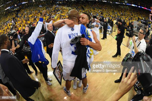 Stephen Curry and David West of the Golden State Warriors celebrate after winning the 2017 NBA Finals on June 12 2017 at ORACLE Arena in Oakland...