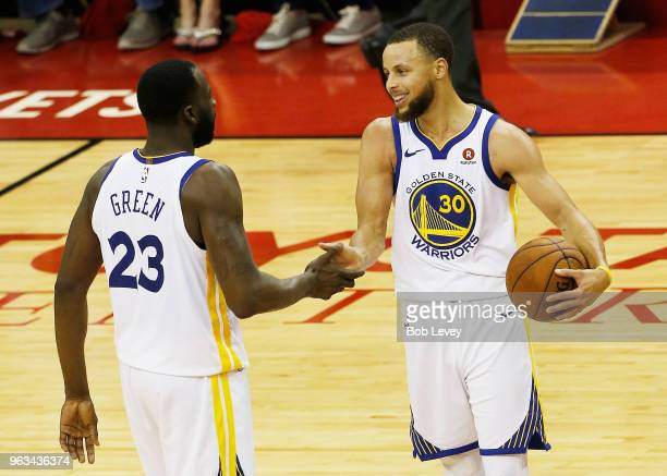 Stephen Curry and Draymond Green of the Golden State Warriors celebrate after they defeated the Houston Rockets 101 to 92 in Game Seven of the...