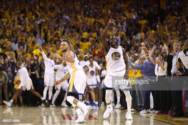 Stephen Curry and Draymond Green of the Golden State Warriors along with their bench react late in the game against the Cleveland Cavaliers in Game 5...