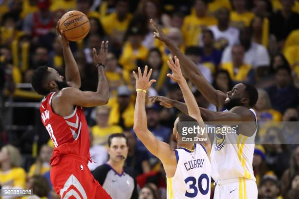 Stephen Curry and Draymond Green of the Golden State Warriors defend James Harden of the Houston Rockets during Game Six of the Western Conference...