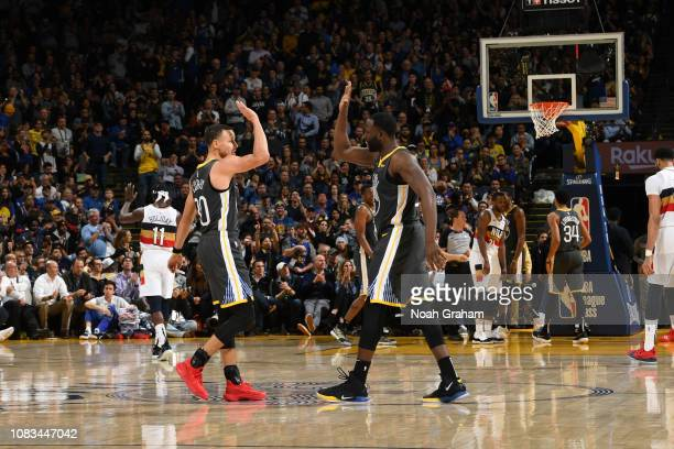 Stephen Curry and Draymond Green of the Golden State Warriors highfive during a game against the New Orleans Pelicans on January 16 2019 at ORACLE...