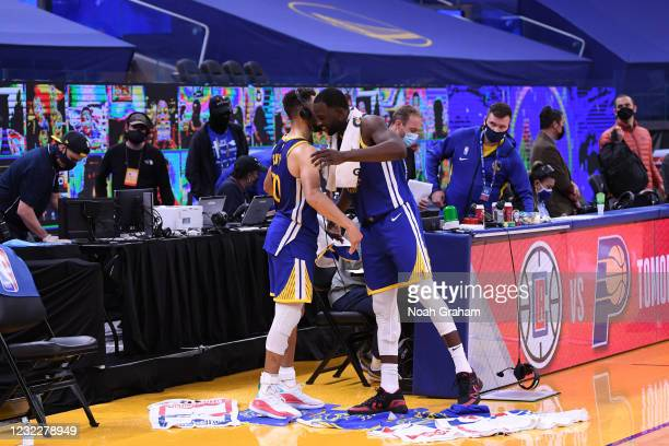 Stephen Curry and Draymond Green of the Golden State Warriors hug after the game against the Denver Nuggets on April 12, 2021 at Chase Center in San...