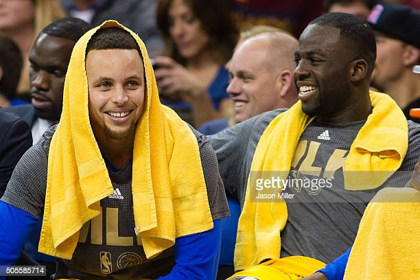 Stephen Curry and Draymond Green of the Golden State Warriors joke on the bench during the fourth quarter against the Cleveland Cavaliers at Quicken...