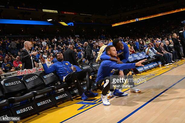Stephen Curry and Draymond Green of the Golden State Warriors pose for a photo on the court before the game against the Los Angeles Lakers on...