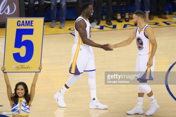 Stephen Curry and Draymond Green of the Golden State Warriors prepare for the opening tipoff in Game 5 of the 2017 NBA Finals against the Cleveland...