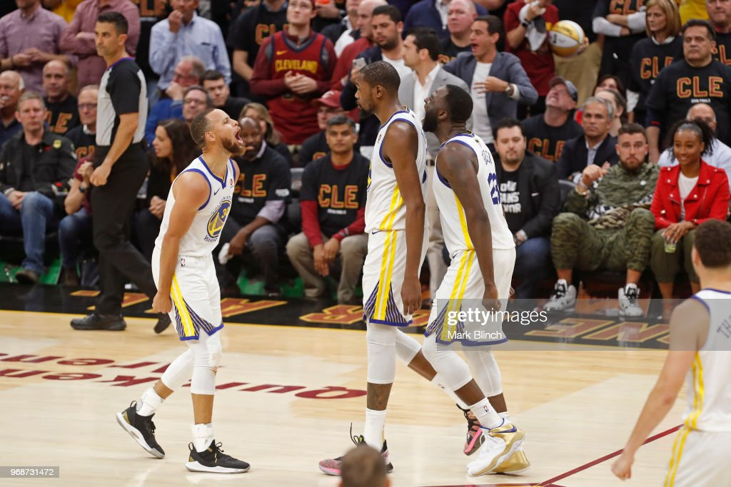 Stephen Curry #30 and Draymond Green #23 yell and celebrate with Kevin Durant #35 of the Golden State Warriors in Game Three of the 2018 NBA Finals against the Cleveland Cavaliers on June 6, 2018 at Quicken Loans Arena in Cleveland, Ohio.
