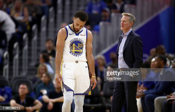 Stephen Curry and head coach Steve Kerr of the Golden State Warriors react after a play during their game against the LA Clippers at Chase Center on...