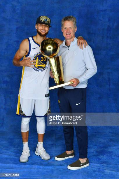 Stephen Curry and Head Coach Steve Kerr of the Golden State Warriors pose for a portrait with the Larry O'Brien Championship trophy after defeating...