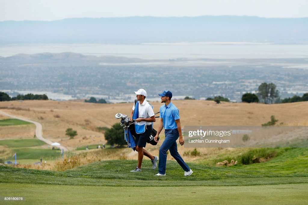 Stephen Curry and his caddie Jonnie West walk to the eighteenth green during round one of the Ellie Mae Classic at TCP Stonebrae on August 3, 2017 in Hayward, California.