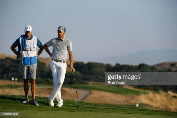Stephen Curry and his caddy Jonnie West wait to play their next shot during the second round of the Webcom Tour Ellie Mae Classic at TPC Stonebrae on...