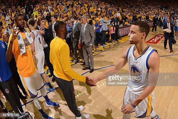 Stephen Curry and Ian Clark of the Golden State Warriors shake hands in Game Five of the Western Conference Finals against the Oklahoma City Thunder...