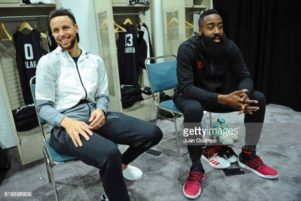 Stephen Curry and James Harden of Team Stephen talk in the locker room before NBA AllStar Media Day Practice as part of 2018 NBA AllStar Weekend at...