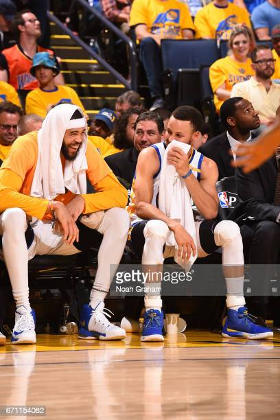 Stephen Curry and JaVale McGee of the Golden State Warriors laugh on the bench during Game Two of the Western Conference Quarterfinals against the...