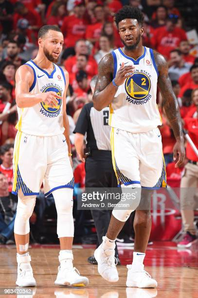 Stephen Curry and Jordan Bell of the Golden State Warriors talk during the game against the Houston Rockets during Game Seven of the Western...