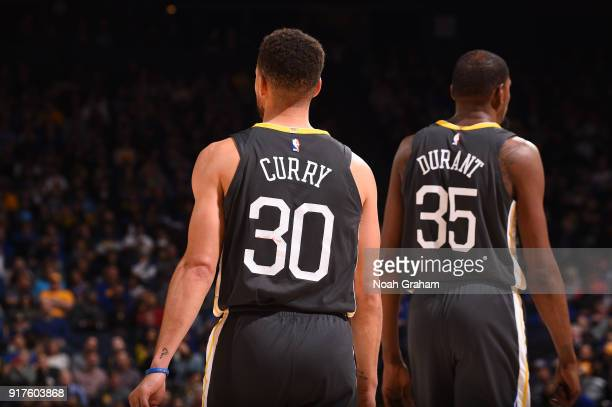 Stephen Curry and Kevin Durant of the Golden State Warriors are seen during the game against the Phoenix Suns on February 12 2018 at ORACLE Arena in...