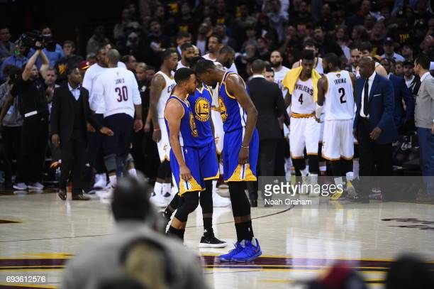 Stephen Curry and Kevin Durant of the Golden State Warriors celebrate against the Cleveland Cavaliers in Game Three of the 2017 NBA Finals on June 7...