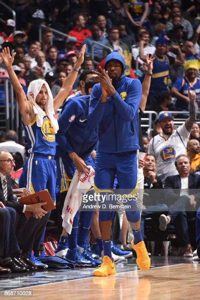 Stephen Curry and Kevin Durant of the Golden State Warriors celebrate from the bench against the LA Clippers on October 30 2017 at STAPLES Center in...
