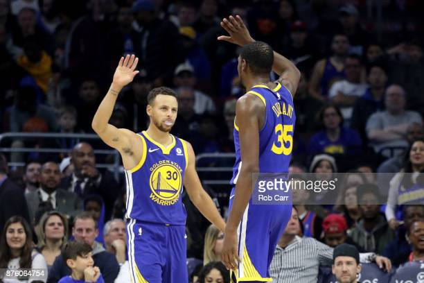 Stephen Curry and Kevin Durant of the Golden State Warriors celebrate during the end of the Warriors 124116 win over the Philadelphia 76ers at Wells...