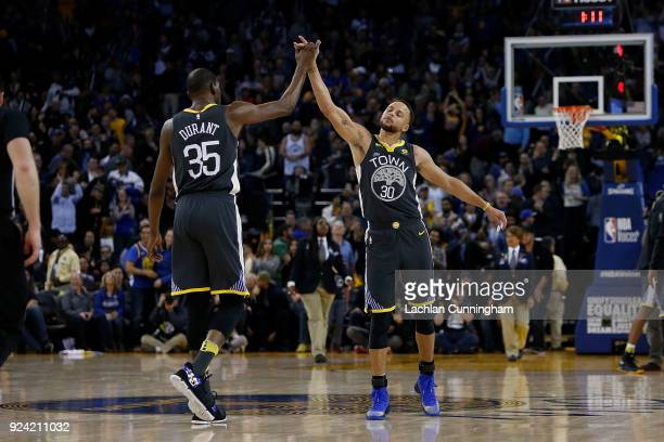 Stephen Curry and Kevin Durant of the Golden State Warriors celebrate during the game against the Los Angeles Clippers at ORACLE Arena on February 22...