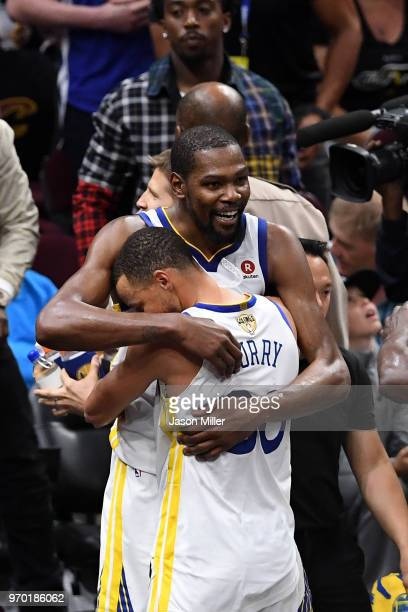 Stephen Curry and Kevin Durant of the Golden State Warriors celebrate late in the game against the Cleveland Cavaliers during Game Four of the 2018...