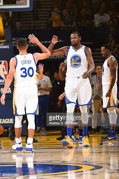 Stephen Curry and Kevin Durant of the Golden State Warriors high five during the game against the Oklahoma City Thunder on November 3 2016 at ORACLE...