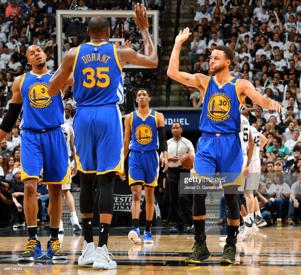 44dc774c1990 Stephen Curry and Kevin Durant of the Golden State Warriors high ...
