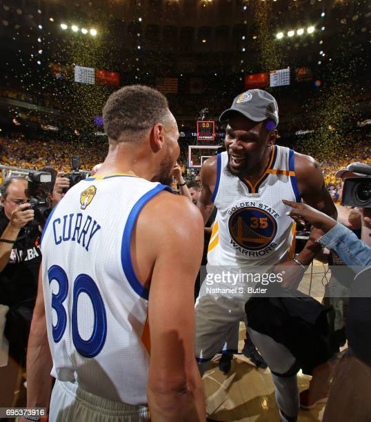 Stephen Curry and Kevin Durant of the Golden State Warriors high five and celebrate after winning Game Five of the 2017 NBA Finals against the...