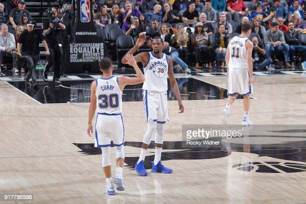 Stephen Curry and Kevin Durant of the Golden State Warriors high five during the game against the Sacramento Kings on February 2 2018 at Golden 1...