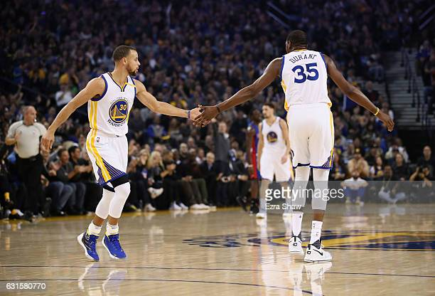 Stephen Curry and Kevin Durant of the Golden State Warriors highfive during their game against the Detroit Pistons at ORACLE Arena on January 12 2017...