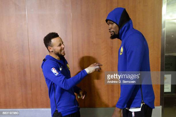 Stephen Curry and Kevin Durant of the Golden State Warriors laugh in the hallway before the game against the Los Angeles Lakers on November 29 2017...